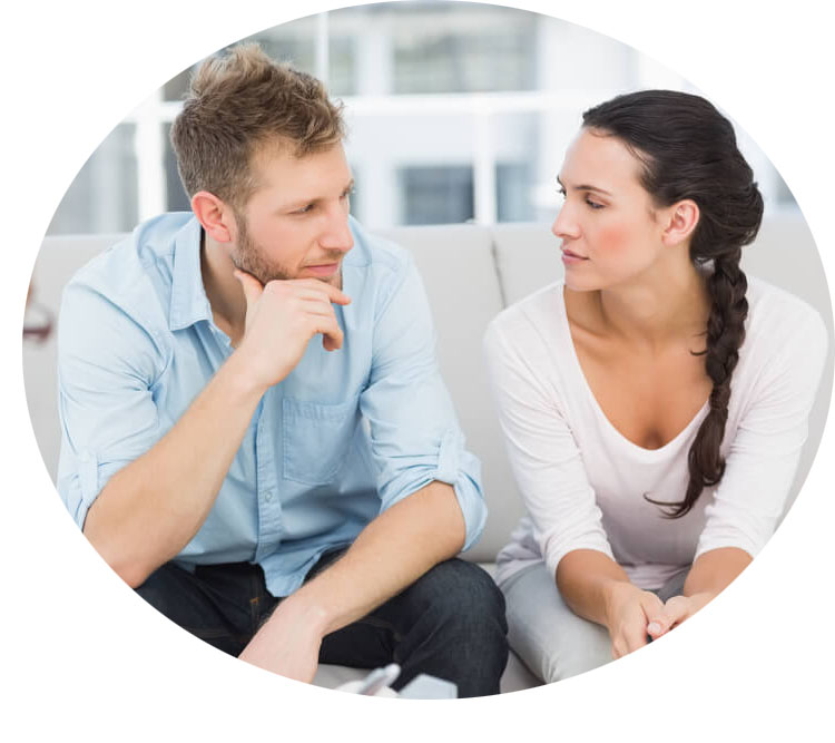 A man and woman in couples counseling